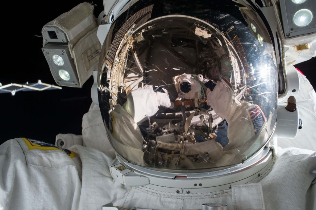 reflection-off-space-helmet-in-space